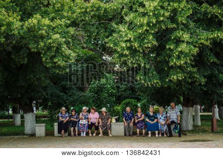 ARMAVIR, RUSSIA - JULE 02, 2016: Older people are sitting on a Park bench on a summer day