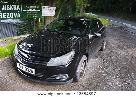 2016/07/03 Brezova Czech republic - black car improvised parked in front of the village Brezova in Karlovarsky kraj region during the summer tourist season