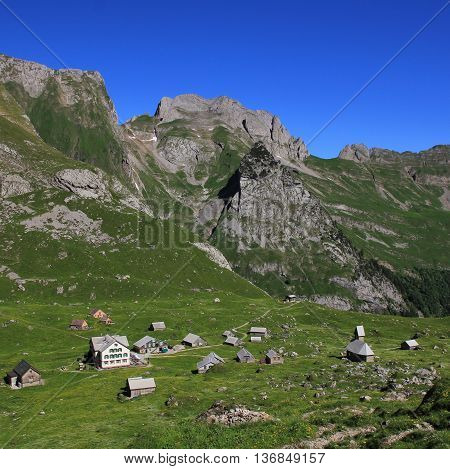 Old houses and chapel on the Meglisalp. Settlement high up in the mountains of Appenzell Canton.
