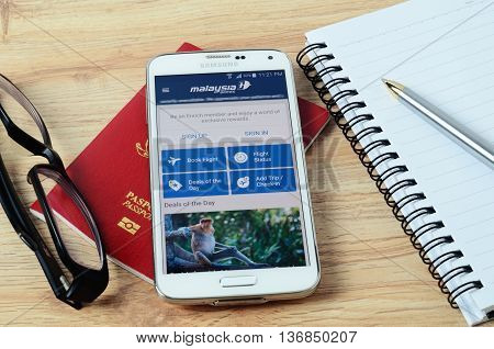 KOTA KINABALU MALAYSIA - JULY 1 2016: Malaysia Airlines on mobile app the app helps managing travel plans make bookings check-in and choose seat anytime anywhere.