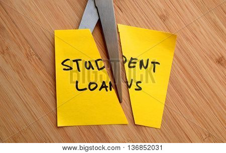 student loans cut in half- university/college concept