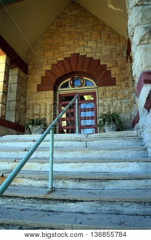 JOLIET, ILLINOIS / UNITED STATES - NOVEMBER 1, 2015: The front door of the Old Central Presbyterian Church, which now serves as a wedding chapel, in downtown Joliet.