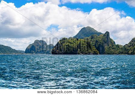 Rough sea by Cadlao island. El-nido on Background, Palawan, Philippines.