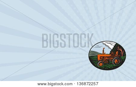 Business card showing illustration of a vintage tractor with farm grass tree sky clouds in the background set inside oval shape done in retro woodcut style.