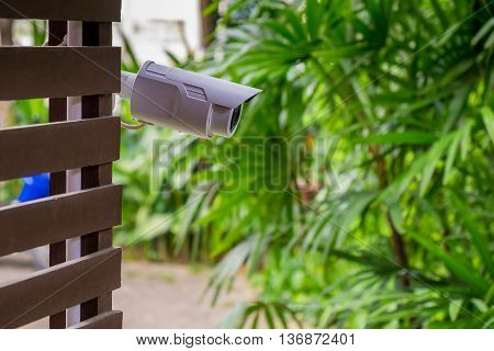 CCTV Security Camera or surveillance system in the house. poster