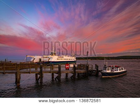 Bournemouth to Swanage Ferry in Poole Harbour under deep red skies