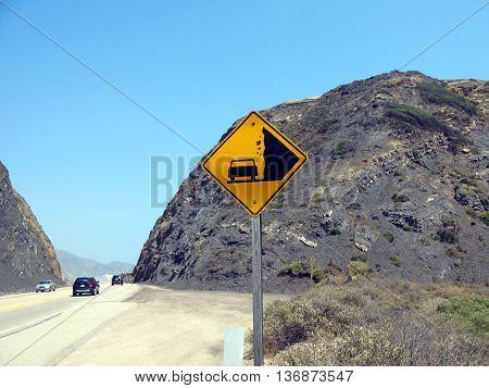 Sign warning of falling rocks along pacific coast highway near Malibu, California.