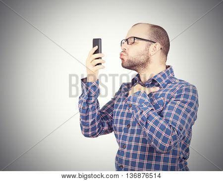 Caucasian Man Doing A Selfie With A Kiss.