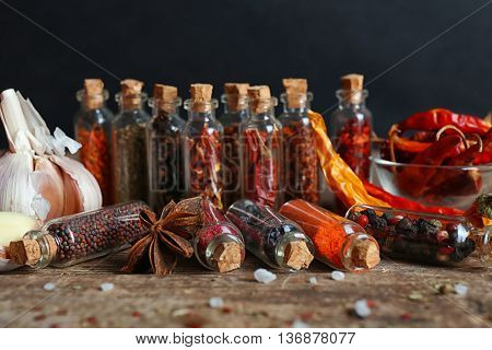 Assorted dry spices in glass bottles, close up