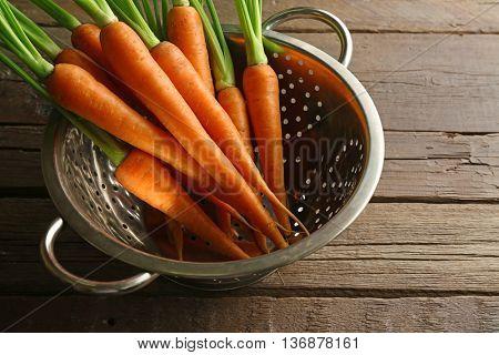 Carrots in colander, closeup