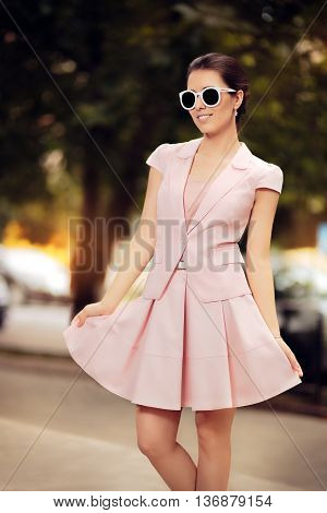 Fashionable Woman in Pink Suit with Skirt and Sunglasses