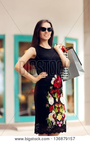 Woman with Shopping Bags in front of a Clothing Store