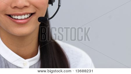 Close-up of a businesswoman using headset at work