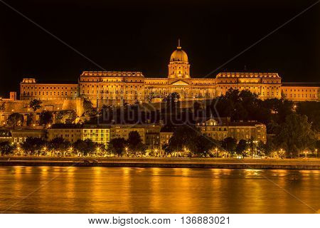 Buda Castle Danube River Reflection Budapest Hungary. Buda Castle was first built in 1242 and enlarged by Empress Maria Theresa in the 1700s.