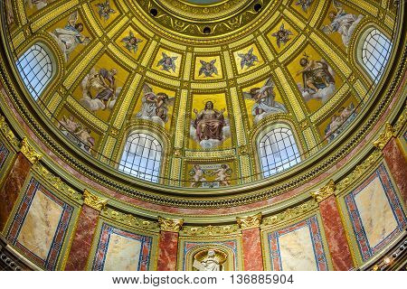 BUDAPEST, HUNGARY -  JUNE 10, 2016  Dome Christ Basilica Arch Saint Stephens Cathedral Budapest Hungary. Saint Stephens named after King Stephens who brought Christianity to Hungary. Cathedral built in the 1800s and consecrated in 1905.