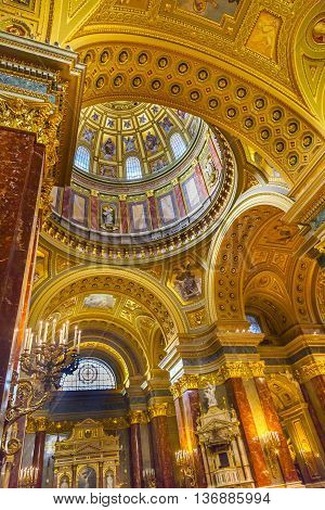 BUDAPEST, HUNGARY -  JUNE 10, 2016  Dome God Christ Basilica Arch Saint Stephens Cathedral Budapest Hungary. Saint Stephens named after King Stephens who brought Christianity to Hungary. Cathedral built in the 1800s and consecrated in 1905.