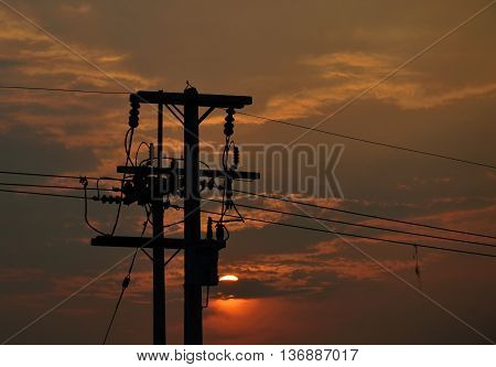 high voltage electric pole on sunset sky