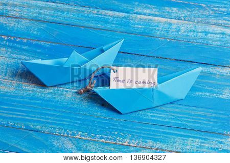 Paper Boat With A Sign Time Is Coming- Travel Concept