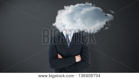 Frowning businessman looking at camera against grey background