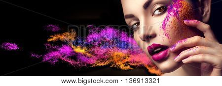 Fashion model girl portrait with colorful powder make up. Beauty woman with bright color makeup. Close-up of Vogue style lady face, Abstract colourful make-up, Art design. Black background