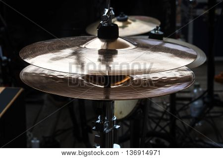 hi-hat on stage combination cymbal in a percussion drum kit for pop rock jazz folk music and more dark ambient selected focus narrow depth of field
