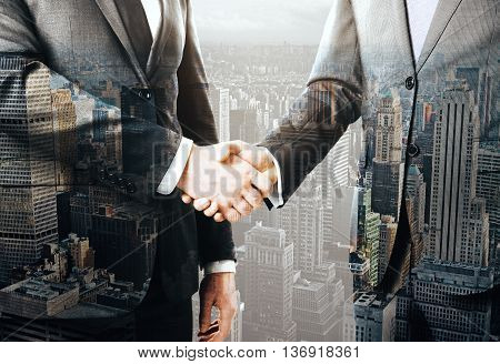Businesspeople shaking hands on New York city background. Concept of partnership. Double exposure