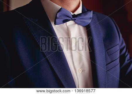 Groom prepares for wedding. groom getting ready in suit.