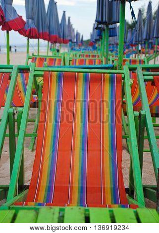 Umbrellas and beach chairs on Cha um beach Thailand.