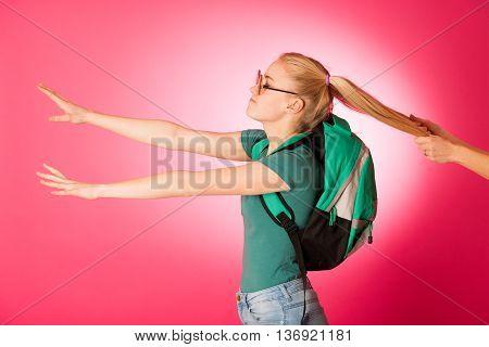Stubborn, Angry Schoolgirl Resisting To Go To School.
