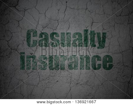 Insurance concept: Green Casualty Insurance on grunge textured concrete wall background