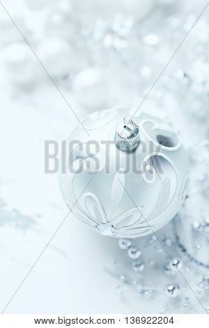 Silver and white Christmas ornaments (close up)