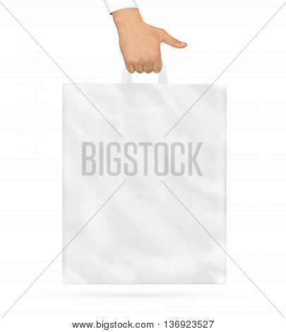 Blank plastic bag mock up holding in hand. Empty polyethylene package mockup hold in hands isolated on white. Pack ready for logo design or supermarket identity presentation. Product store packet.