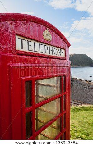 Telephone box in remote costal location in the village of Crovie in Scotland.