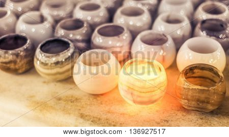 marble stone candle holders in a row