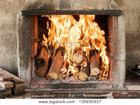 Burning wood in the fireplace. Strong flame