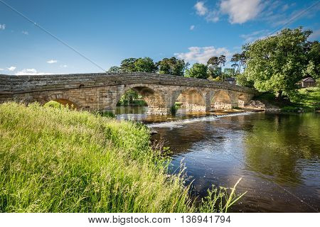 Pauperhaugh Bridge and Weir, just downstream from Rothbury town on the River Coquet in Northumberland