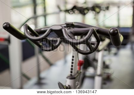 Close-up of exercise bike handlebar in spinning class
