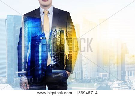 Front view of businessman in suit on Singapore city background with sunlight. Double exposure