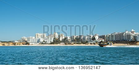 ALGARVE COAST PORTUGAL - MAY 19: A view of the city and the outlook boat near the coast Algarve in Portugal 2016