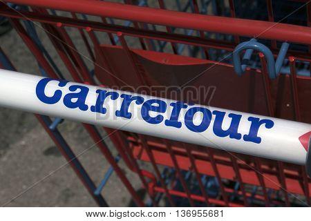 Paris France-June 20 2016: letters Carrefour on a shopping cart in Paris