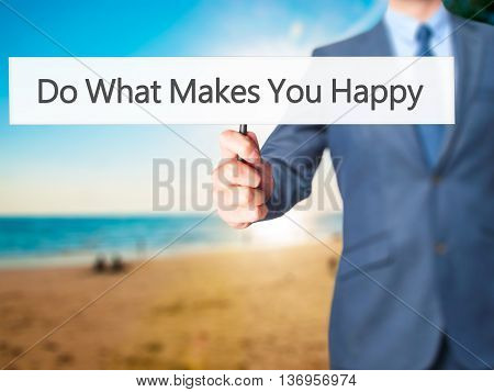 Do What Makes You Happy - Businessman Hand Holding Sign