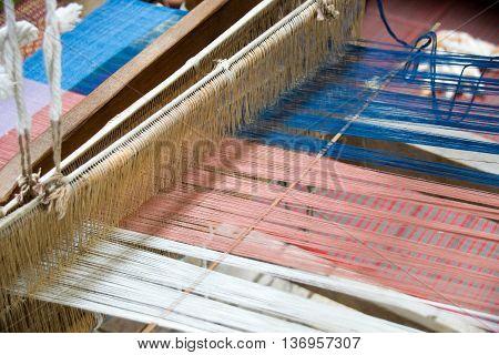 Close up Loom weaving silk in thailand