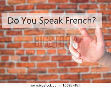 Do You Speak French ? - Hand Pressing A Button On Blurred Background Concept On Visual Screen.