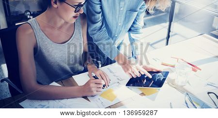 Coworkers Work Process Modern Office Studio.Young Professional Making Great Decision New Creative Idea.Business Team Working Startup.Digital Tablet Wood Table.Analyze Market Report.Blurred.Film Effect