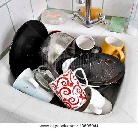 the various dirty dishes in the sink