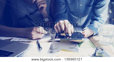 Photo Woman Hand Touching Digital Tablet Screen.Analyst Department Researching Process.Young Business Crew Working New Startup modern Studio.Analyze markets stocks.Blurred, film effect.Wide