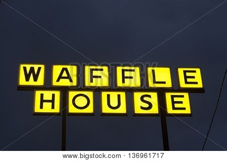 DALLAS Tx USA - APR 17 2016: Waffle House fast food restaurant logo illuminated at night. Dallas Texas United States