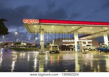 DALLAS Tx USA - APR 17 2016: Exxon gas station illuminated at night. Dallas Texas United States