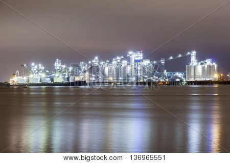 Refinery at the Mississippi River in Baton Rouge illuminated at night. Louisiana United States