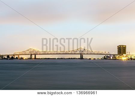Crescent City Connection bridge in New Orleans illuminated at night. Louisiana United States